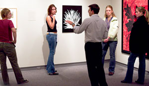 A professor lectures to a group of students in the Richards Art Gallery