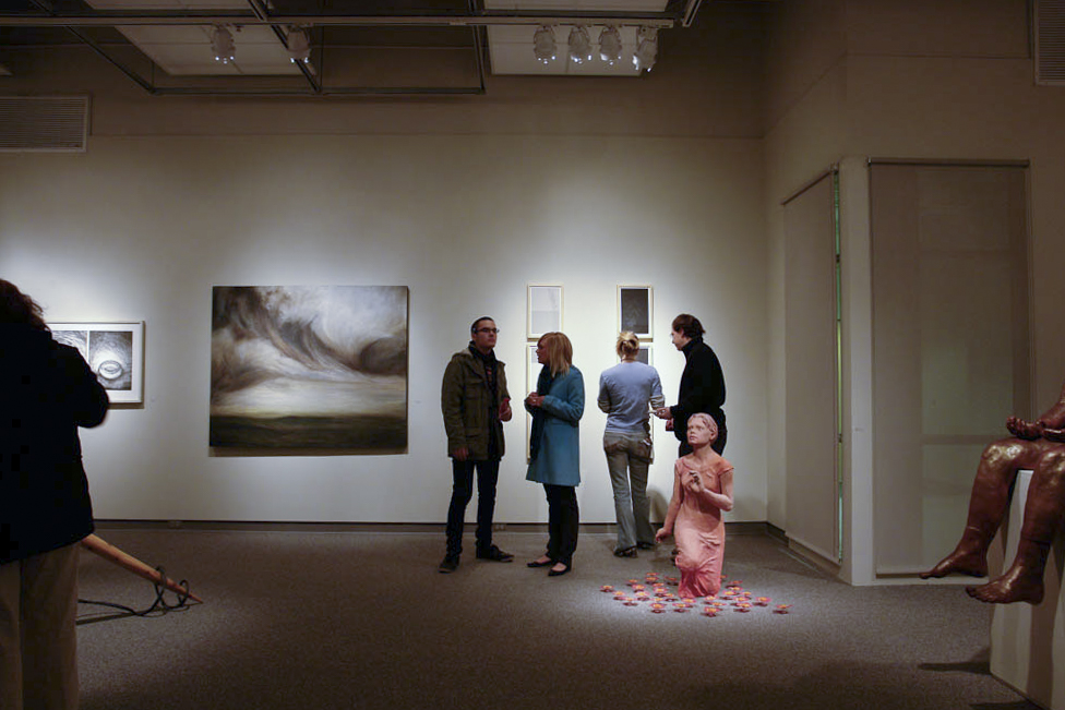 People view art at a gallery