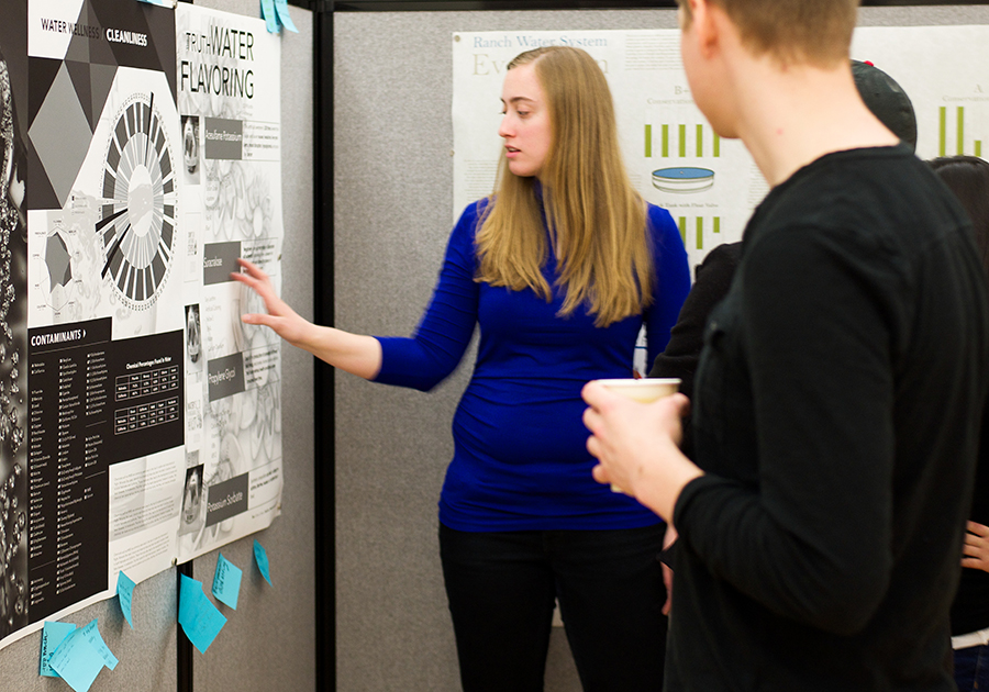 A Graphic Design student presents an infographic at the 40th annual Center for Great Plains Studies Symposium
