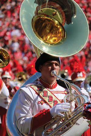 Tuba player in the Cornhusker Marching Band playing at Memorial Stadium