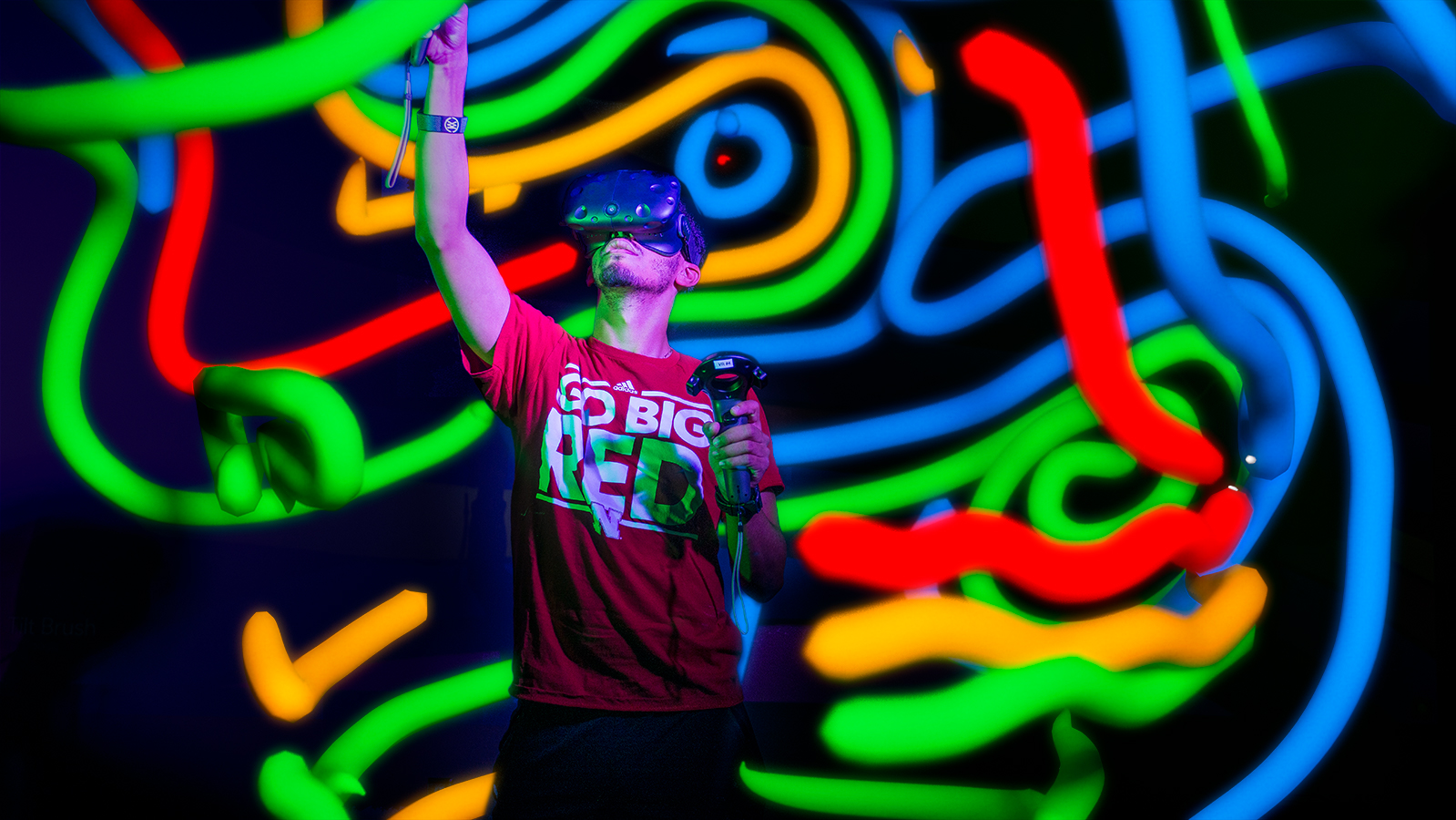 Image of student using VR headset with rendered graphics surrounding him.