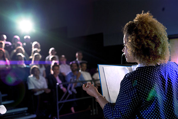 Person talking in front of an audience