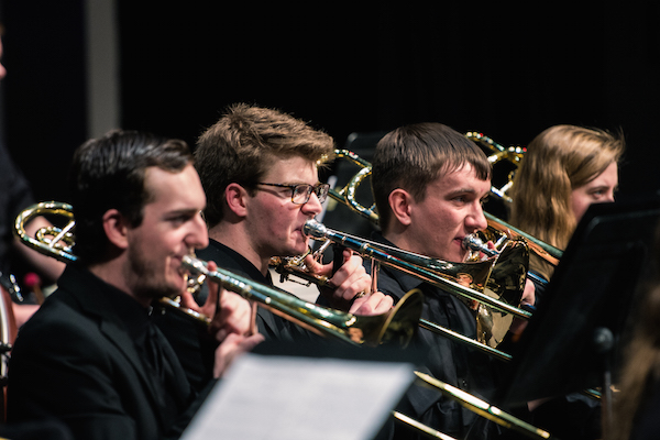 Trombones perform with the Symphonic Band
