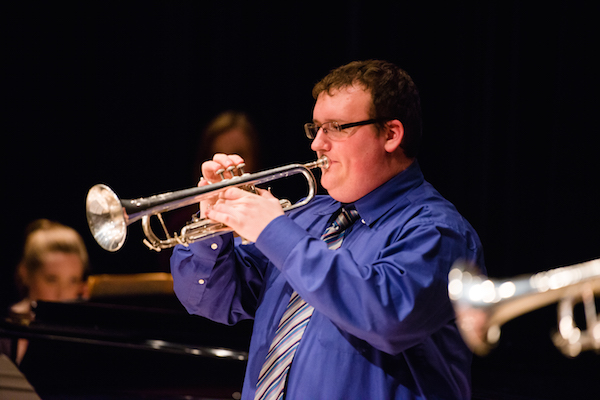 Trumpet player performs in Westbrook