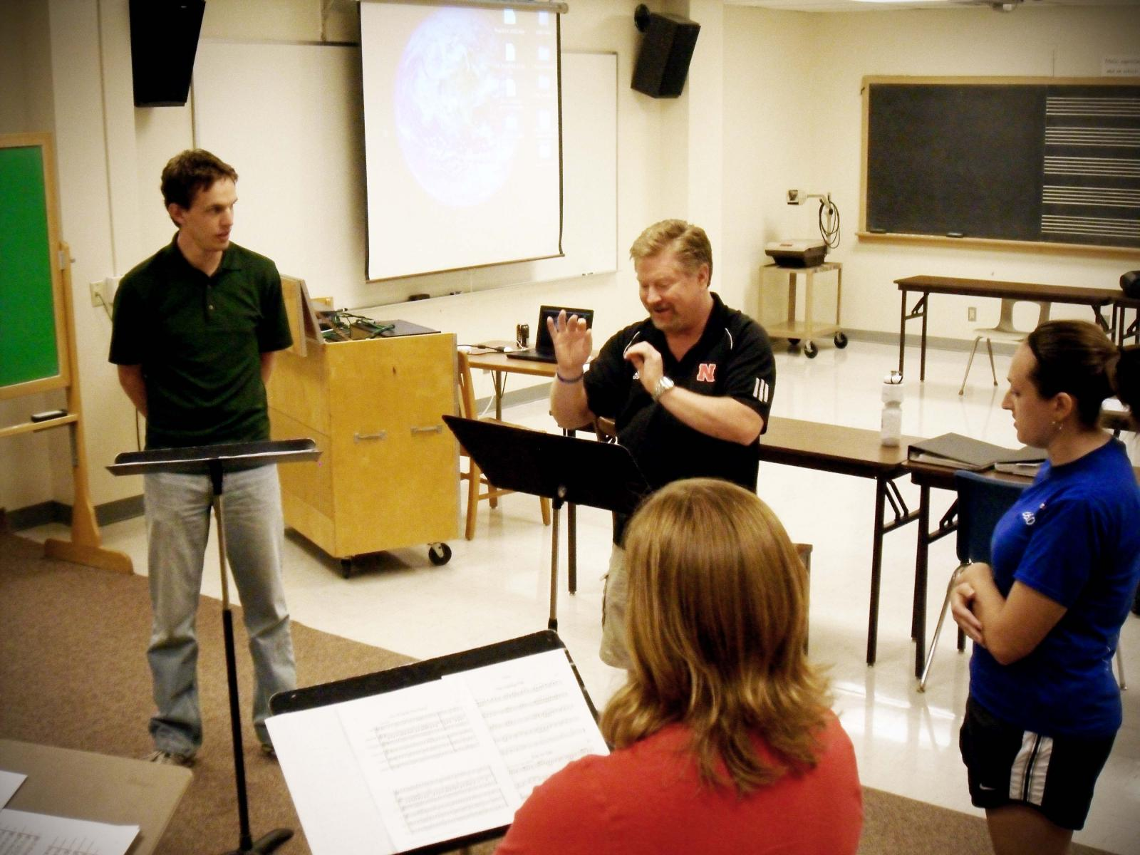 Professor Doug Bush leads a class in conducting.