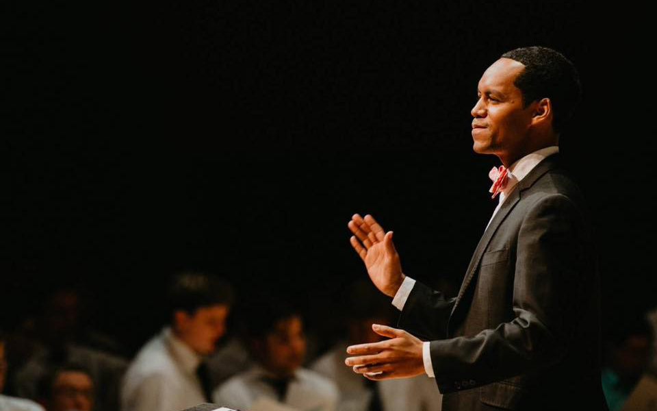 Garrett on stage at the 2018 Men's Choral Festival