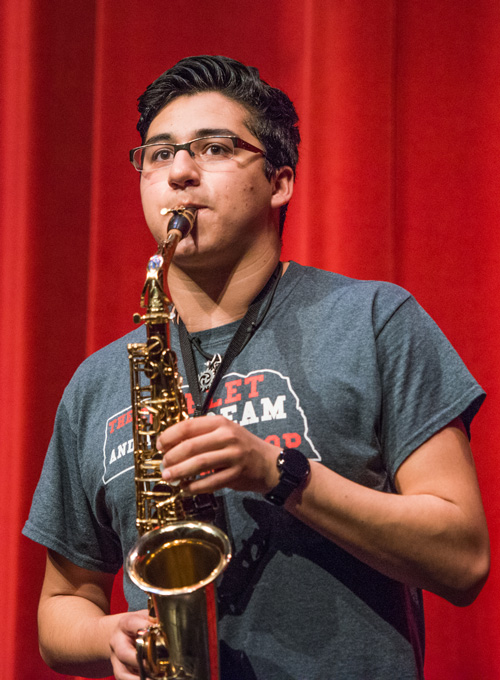Portrait of Ricky playing saxophone on stage