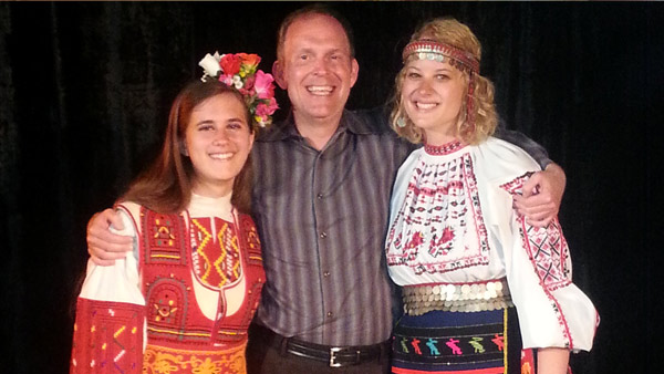 Professor of Piano Mark Clinton with UNL students Emily Callahan (left) and Jennifer Weier after the final concert of the International Chamber Music Festival, when many of the students were dressed in traditional Bulgarian clothing.