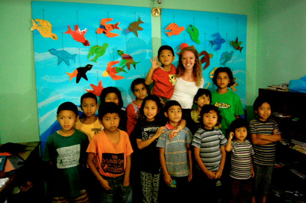 Photo of Hannah Potter in Nepal with a group of children