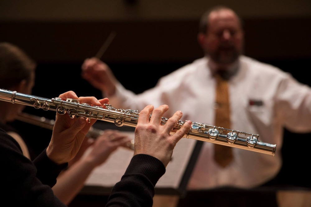 John Bailey conducting the flute ensemble