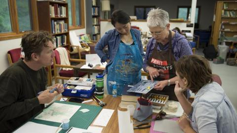 Karen Kunc, professor of art, discusses a printmaking techique with students enrolled in the Art at Cedar Point course. The new summer course is held at the UNL's Cedar Point Biological Station and allows students to focus solely on creating art for two weeks. Photo by Troy Fedderson.