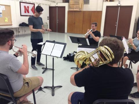 Composer Andrew Rodriguez and the Faust Brass Quintet