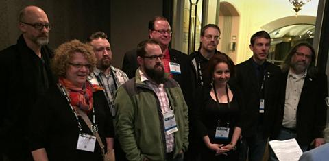 Laurel Shoemaker (2nd from left) and J.D. Madsen (third from left) are sworn into membership into the United Scenic Artists, Local USA 829, during the United States Institute of Theatre Technology's annual conference in March in Cincinnati, Ohio.