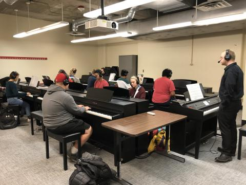 Students take part in a skills class in the large piano lab in Westbrook.