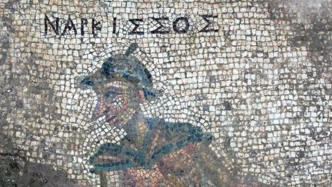 The mythological figure Narcissus appears in this detail of an ancient latrine's mosaic floor. Courtesy photo.