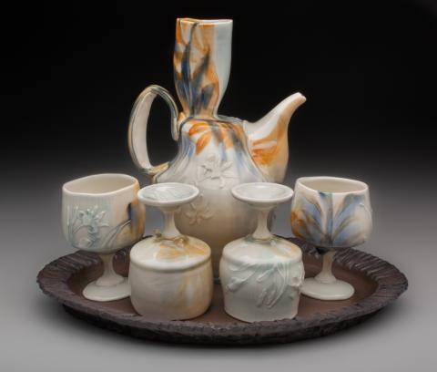 """Taylor Sijan, """"Wine Set,"""" porcelain, stoneware, epoxy, 10"""" x 7"""" x 5.5"""" (ewer), 4.5"""" x 3"""" x 3"""" (cups), 1"""" x 15"""" x 12"""" (tray), 2020."""