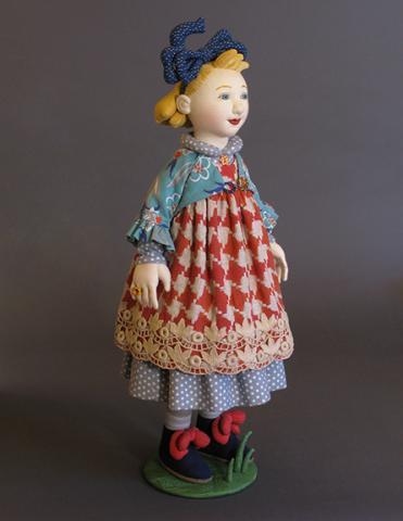 """Shelley Thornton, """"REMY,"""" fabric, wool batting, wooden balls, 2009."""