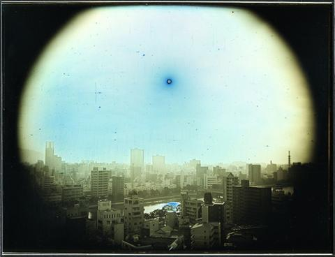 "Takashi Akai's daguerreotype titled ""The Sun at the Apparent Altitude of 570 meters in West-Northwest Hiroshima"" from ""Exposed in a Hundred Suns."""