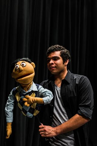 "Matthew Carter plays Princeton in ""Avenue Q."" Photo by John Ficenec."