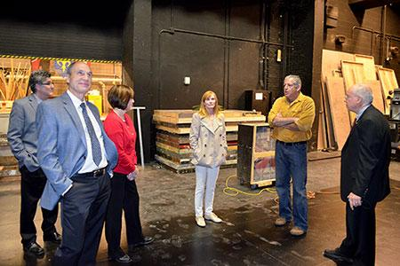 (L-R) Board members Hixson-Lied Endowed Dean Charles O'Connor, Mike Hill, Susan Varner Wilkins, Marg Helgenberger and Deon Bahr tour the Temple Building with Production Manager Brad Buffum (second from right) during their April 27 Hixson-Lied Board meeting.