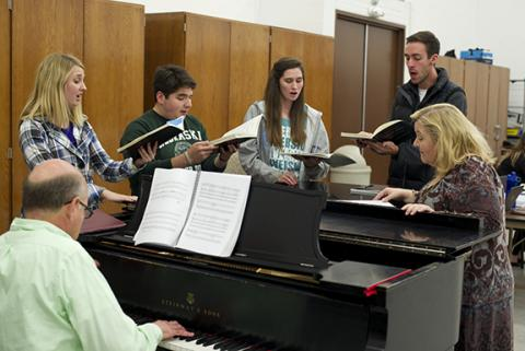 Coordinator of Musical Theatre Studies Alisa Belflower (right) rehearses with (left to right) Jamie Unger, Christian Cardona, Kourtlin Churchman and Brady Foreman with Michael Cotton, piano.
