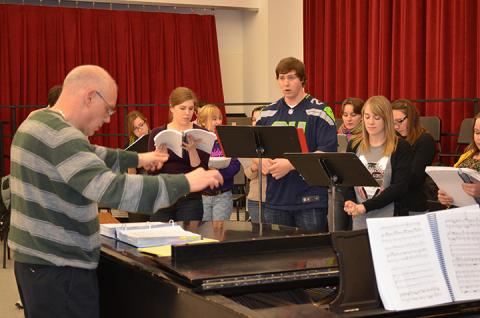 "Hixson-Lied Professor William Shomos (left) directs a music rehearsal with the cast of ""Cendrillon."" Performances of the opera are Feb. 21 and 23 in Kimball Hall."