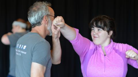 Michelle Ingle practices stage combat with Paul Steger, professor of theatre and film. Photo by Michael Reinmiller.