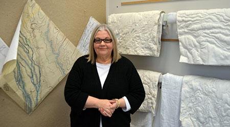 Elizabeth Ingraham on her studio with some of the Terrain Squares in progress