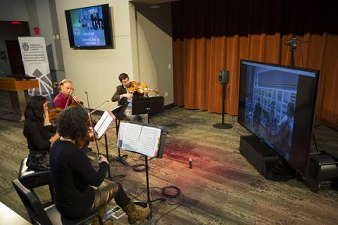 The Chiara String Quartet rehearses with the Avalon Quartet of Northern Illiniois University at Internet2 Day on Nov. 13. Photo by Craig Chandler.