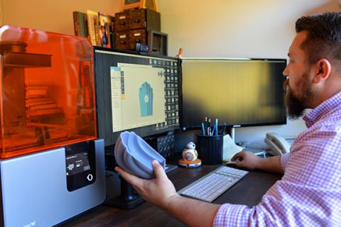 Assistant Professor of Theatre J.D. Madsen adjusts a 3-D design to prepare for printing on the new Formlabs 3-D printer (left). Photo by Michael Reinmiller.