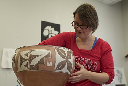 Graduate Student Shalya Marsh recreates a dough bowl from the Zia Pueblo of the Southwest U.S., originally made in about 1890. Photo by Michael Reinmiller.