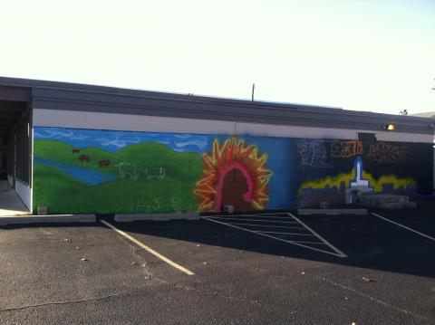 Rikki Neumann's mural, in progress, at 28th and O sts.