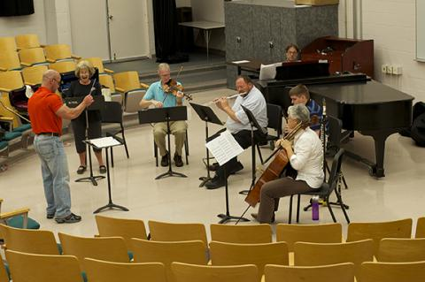 "Jeff McCray conducts Donna Harler-Smith; Clark Potter, viola and violin; John Bailey, flute and piccolo; Kurt Knecht, piano; Lucas Willsie, clarinet and bass clarinet; and Karen Becker, cello, during a rehearsal of ""Pierrot Lunaire."""