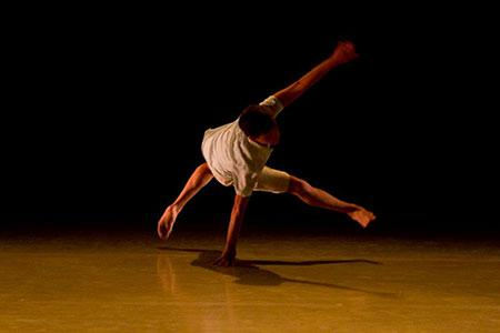 A student rehearses for the performance. - Photo by Fred Schneider