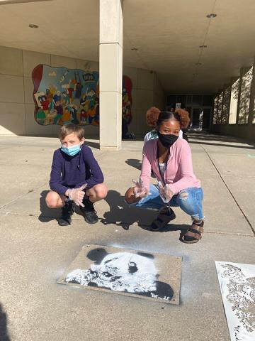 "Students at Park Middle School in Lincoln created spray chalk animals from stencils as part of the ""Stay Wild"" community arts project."