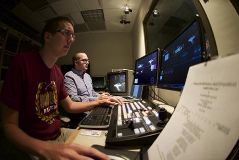Greg Smith (left) and Steven Cohen work in the control booth at NET during a live webcast of a DMA recital of Masayoshi Ishikawa in Westbrook Recital Hall.