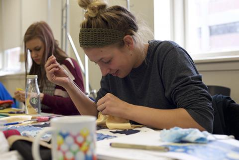 "Allison Wetig, a sophomore studio art major, works on recreating Van Gogh's ""Starry Night."" Photo by Michael Reinmiller."