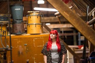 Amy in the props room in the Temple.