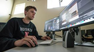Ben working in a Film & New Media lab.