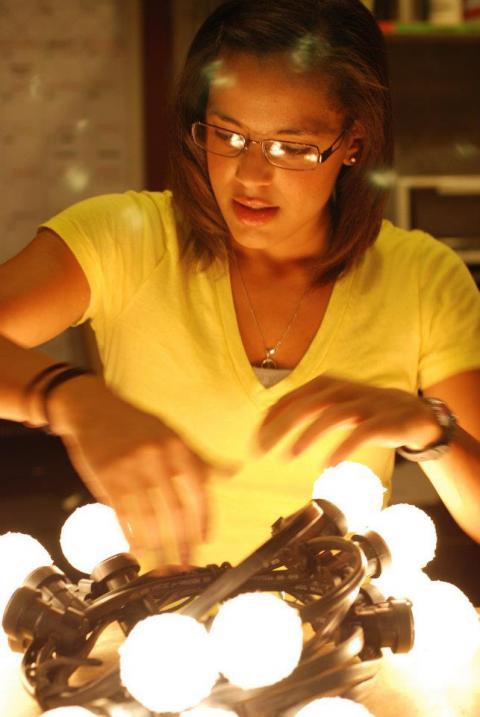 Aja Jackson works with lighting equipment