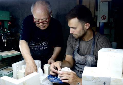 Patrick Kingshill (right) with Takeshi Yasuda in Jingdezhen, China. Photo courtesy of Patrick Kingshill.