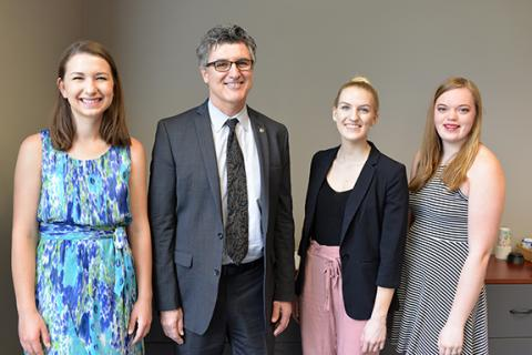 Left to right: Krista Benesch, Dean Chuck O'Connor, Emily Gauger and Haley Collins.