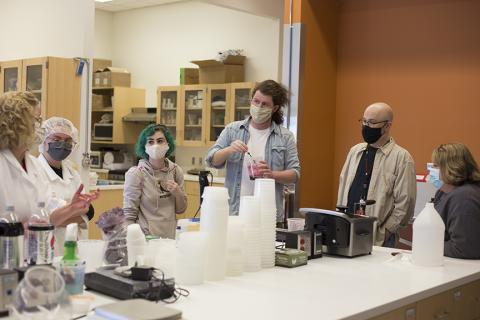 ": (Left to right) Bethany Jackson, Zoe Kraus, Camille Lerner, Nathan Alexander, Jamie Bullins and Julie Reiling work on the perfect formula for the blood used in ""Dracula: Mina's Quest"" at the Food Innovation Center. Photo by Eddy Aldana."
