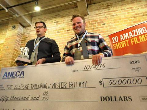 """Alexander Jeffery (left) and Paul Petersen accept the $50,000 cash prize as the grand prize winner of the Louisiana Film Prize for their film, """"The Bespoke Tailoring of Mister Bellamy."""""""