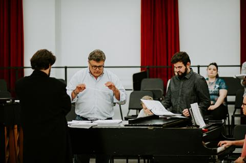 """Tyler White (center) rehearses with Patrick McNally (left) and Matthew Gerhold. The Glenn Korff School of Music is premiering a new opera """"The Gambler's Son"""" by composer Tyler Goodrich White and librettist Laura White."""