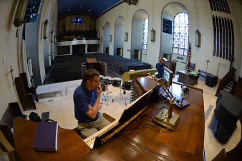 """Dr. Christopher Marks, organ, and Dr. David Hall, percussion, rehearse Knecht's """"Toccata, Adagio, Fugue"""" at First Plymouth Church in Lincoln. Photo by Michael Reinmiller."""