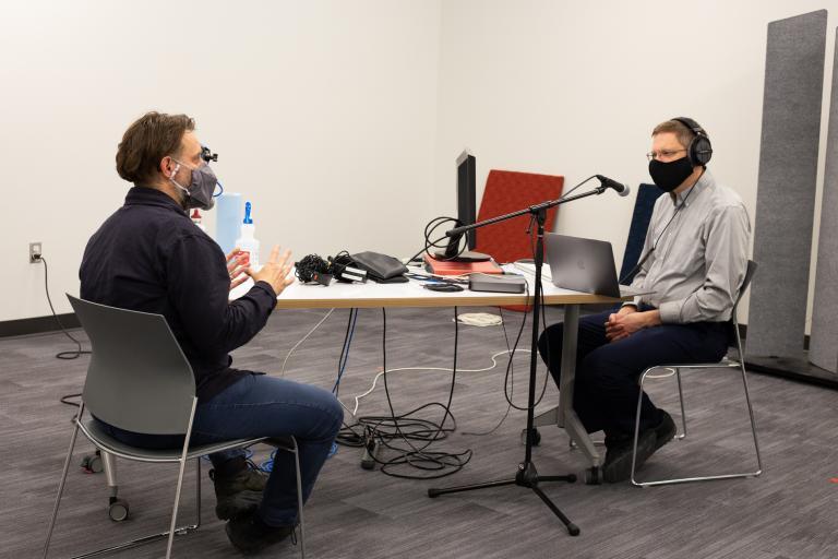 Associate Dean Christopher Marks interviews Assistant Professor of Emerging Media Arts Jesse Fleming for an upcoming episode of the ArtsCast Nebraska podcast. Photo by Eddy Aldana.