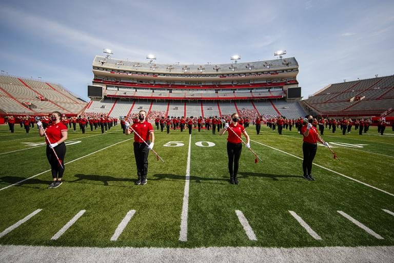 Last year's Cornhusker Marching Band recorded a pregame and halftime performance in Memorial Stadium in October for the virtual game day experience. This year the band will return to performing live at each home game in front of a full stadium of fans. Photo by Craig Chandler, University Communication.