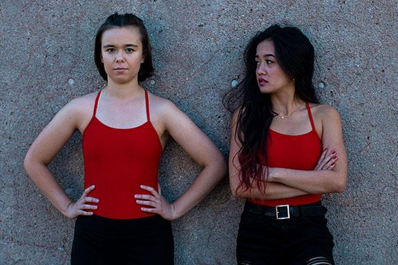 "Kami Cooper (left) and Michaella Deladia star in Theatrix's ""Dry Land."""