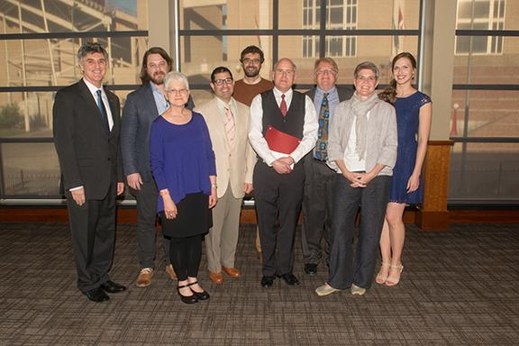 Left to right:  Dean Chuck O'Connor, Aaron Sutherlen, Karen Kunc, Matthew Sontheimer, Philip Sapirstein, Michael Cotton, Michael Hoff, Margaret Bohls and Andrea Maack. Photo by Greg Nathan.